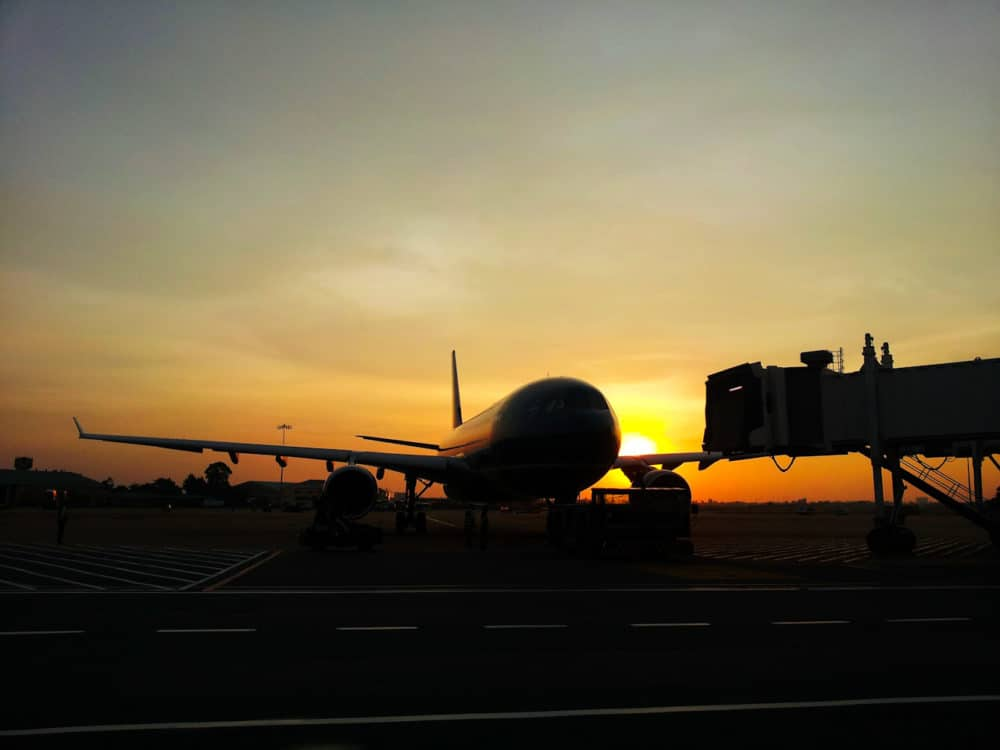 Plane at airport, sunset