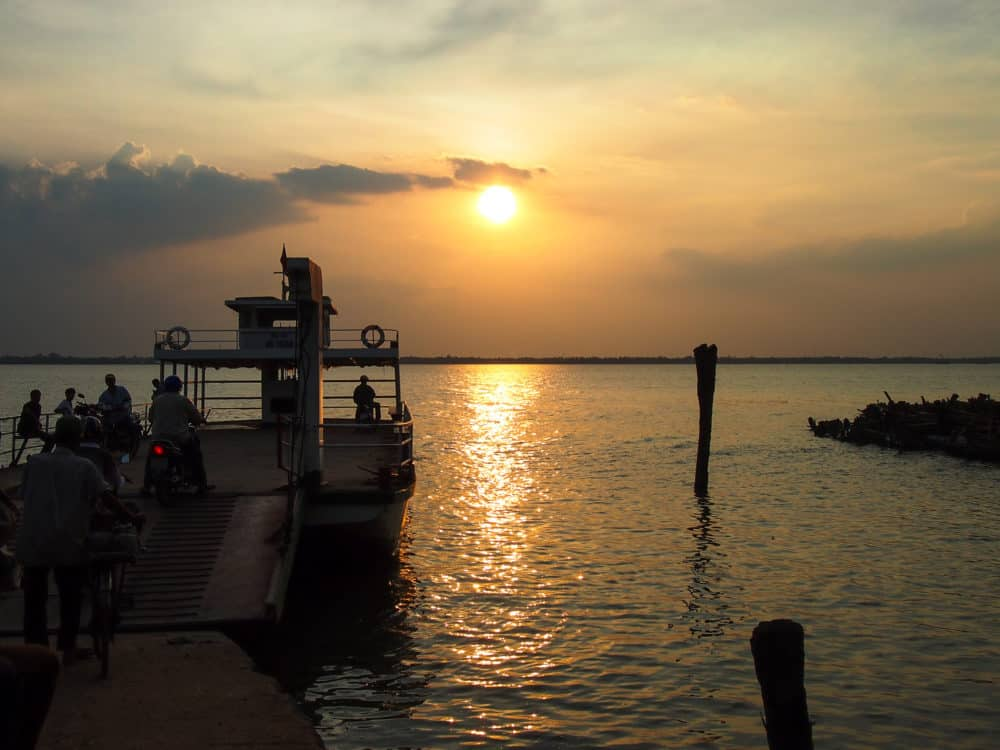 Mekong river ferry at sunset