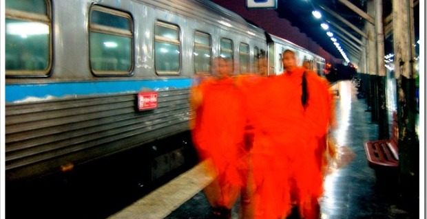 Monks at a train station