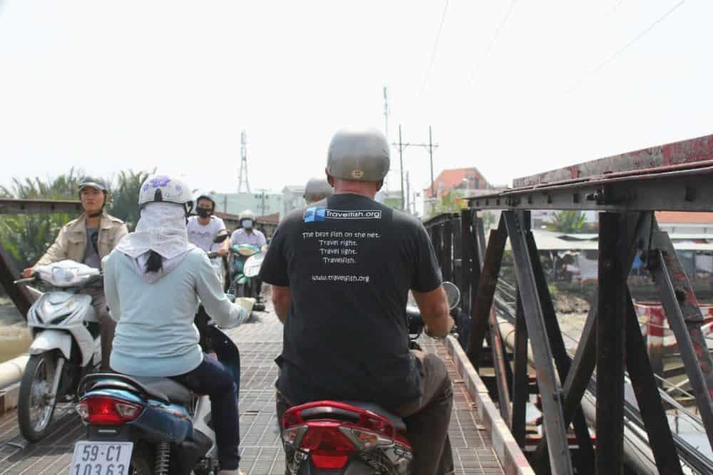 Mekong Delta scooter trip - Stuart on bridge