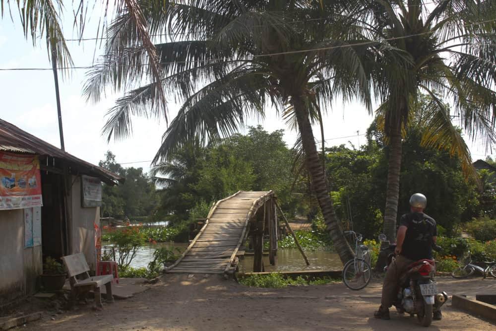 Stuart, scooter, and rickety bridge, Mekong road trip