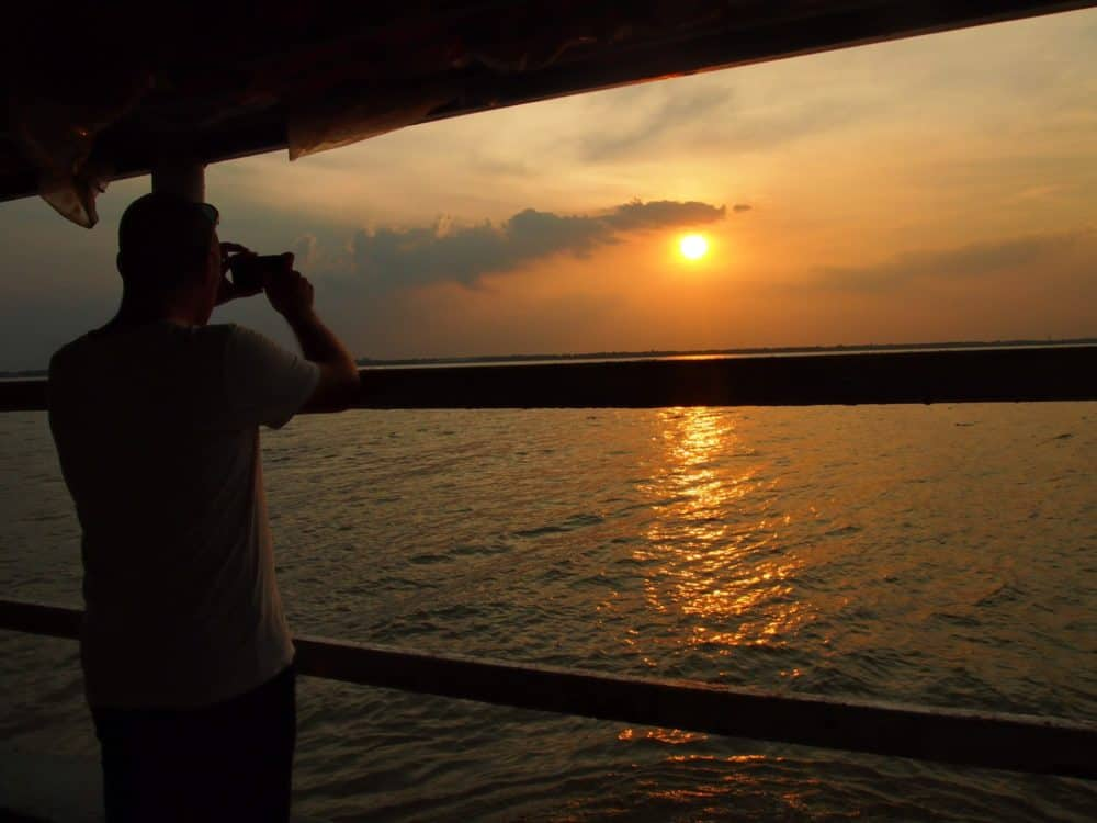 Taking photos of the sunset, Mekong Delta