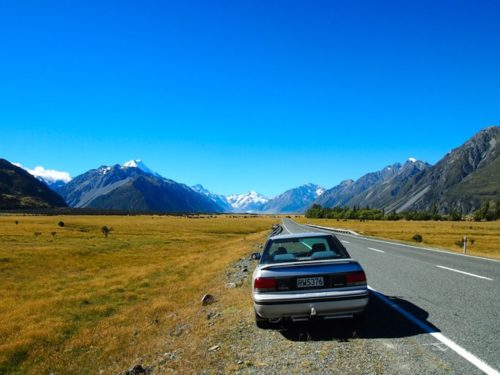 Car on the road to Mount Cook