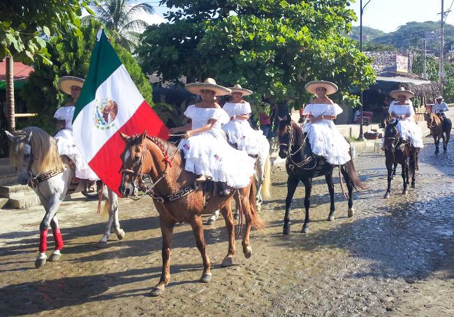 Revolution Day women on horses