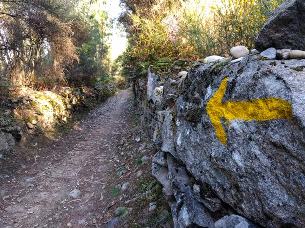 Camino Portuguese arrow on rock