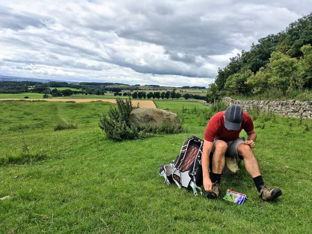 Dave - cap, pack and guidebook, Hadrian's Wall