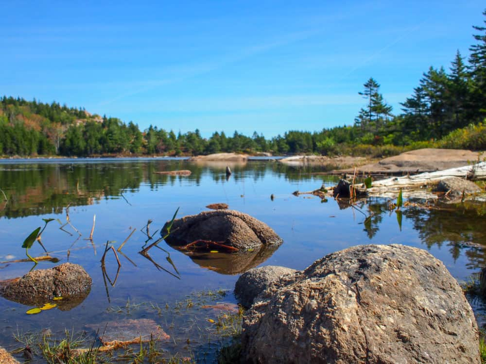 Rocks and water at The Bowl lake, Acadia