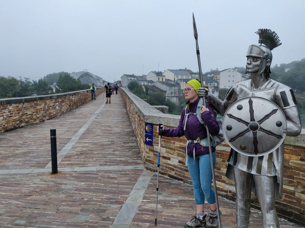 Lauren and a Roman soldier statue in Lugo